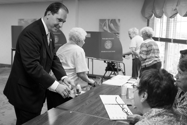 JOED VIERA/STAFF PHOTOGRAPHER-Lockport, NY-Republican candidate for assembly Mike Norris picks up his ballot at Briarwood Manor.