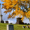 JOED VIERA/STAFF PHOTOGRAPHER-Lockport, NY- The group pointed to this white Washburn monument as roughly what the soon to be renovated Whitcher Civil War Monument might look like at Glenwood Cemetary.