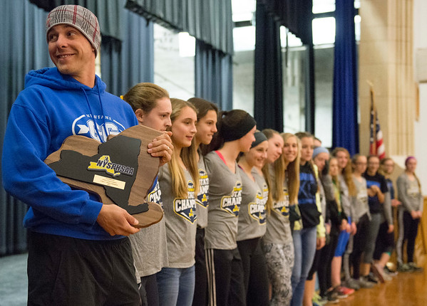 JOED VIERA/STAFF PHOTOGRAPHER-Appleton, NY-Newfane Cross Country coach Mike Heitzenrater  accepts the NYPHSAA Class C Championship Award at Newfane middle school with his team.