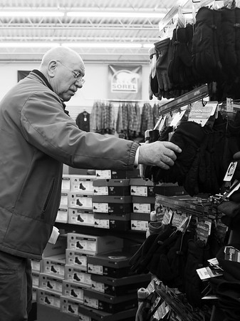 JOED VIERA/STAFF PHOTOGRAPHER-Lockport, NY-  Howard Thompson shops for gloves at the Lockport Outdoor store during their Black Friday sale. The outdoor store is also participating in today's Shop Local Saturday event.