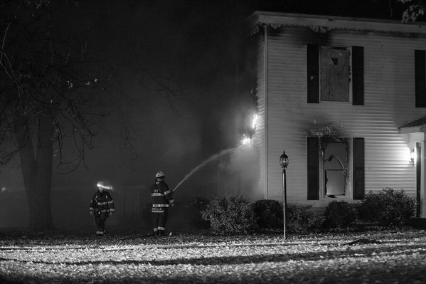 JOED VIERA/STAFF PHOTOGRAPHER-Lockport, NY-Lockport Firefighters work the scene of a fire on East High Street.
