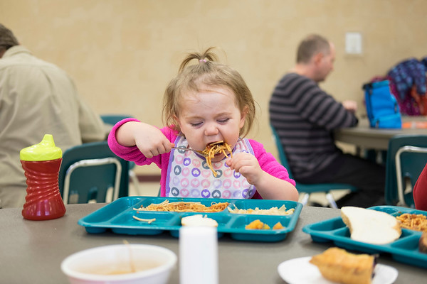JOED VIERA/STAFF PHOTOGRAPHER-Lockport, NY-  Victoria Schultz, 2, enjoys some spaghetti in the Sister Mary Loretto Memorial Soup Kitchen at the Salvation Army