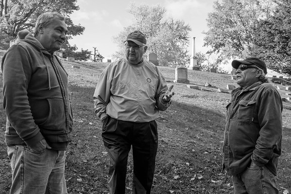 JOED VIERA/STAFF PHOTOGRAPHER-Lockport, NY- Mark Devine, Dennis Devine, and  Randy Kaiser chat about the soon to be renovated Whitcher Civil War Monument at Glenwood Cemetary.
