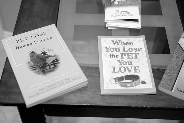 JOED VIERA/STAFF PHOTOGRAPHER- Lockport, NY-self help books for pet owners whove lost their creatures rest on a table inside Pets in Peace.