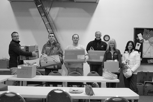 JOED VIERA/STAFF PHOTOGRAPHER- Lockport, NY-SERV volunteers Chris Butler, Benjamin Glajch, Jeff Glajch, Jim Langer , Nancy Sgroi and Jennifer O. D'Andrea-Terreri hold up thanksgiving dinners being donated to veterans by the organization at Christian Faith Chapel.