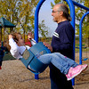 JOED VIERA/STAFF PHOTOGRAPHER-Lockport, NY-Frank Vence pushes his grandchildren Maci and Cole Stopa, 4 and 1, on a swingset at Day Road Park.