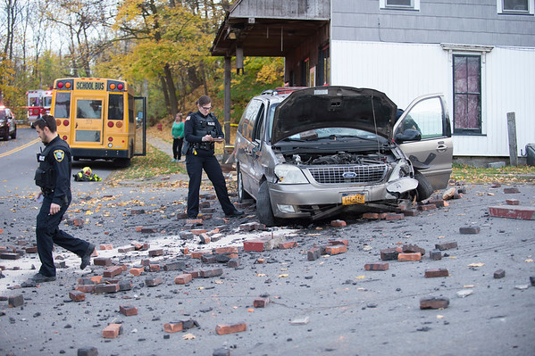JOED VIERA/STAFF PHOTOGRAPHER-Lockport, NY-  Crews work the scene of an accident at the corner of Gooding Street and Glenwood Ave.