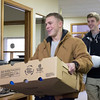 JOED VIERA/STAFF PHOTOGRAPHER- Lockport, NY-Joe Calandra and Achilles Blessios deliver 13 turkeys to the Veterans One Stop Center Tuesday afternoon. The young men are members of Clarence High School's Veterans Assistance Club. The center reached out to veterans on a list and distributed the turkeys throughout Wednesday.