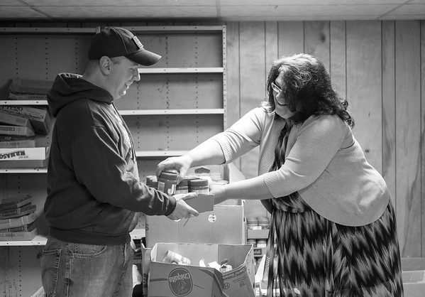 JOED VIERA/STAFF PHOTOGRAPHER-Lockport , NY-Kenny allore and Tracy Williams organize donations for the Annual Peanut Butter and Jelly Drive in the basement of the Second Presbyterian Church on Van Buren St.