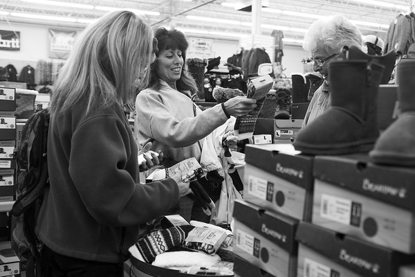 JOED VIERA/STAFF PHOTOGRAPHER-Lockport, NY-   Andreah Werner, Diane Cacioppo and Beatrice Cacioppo shop for socks at the Lockport Outdoor store during their Black Friday sale. The outdoor store is also participating in today's Shop Local Saturday event.