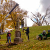 JOED VIERA/STAFF PHOTOGRAPHER-Lockport, NY-A crew works with a crane to re-erect the Whitcher monument Wednesday afternoon.
