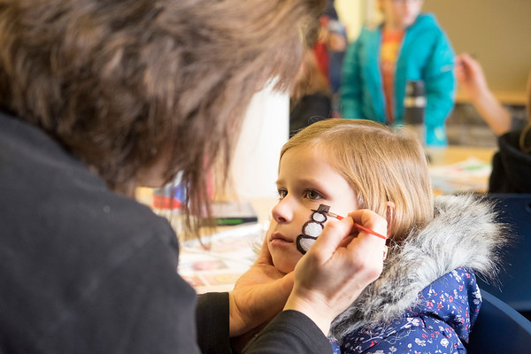 JOED VIERA/STAFF PHOTOGRAPHER-Lockport, NY-    Dawn smith-DeLuca paints a snowman on Josephine Bacon's face. during Hockey Day at Cornerstone Arena.