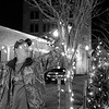 JOED VIERA/STAFF PHOTOGRAPHER- Lockport, NY-Bill Kinney and Mary Schnieder decorate the trees on the Main Street medians with christmas lights.
