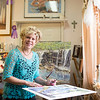 JOED VIERA/STAFF PHOTOGRAPHER- Gasport, NY-Watercolorist Kathleen Giles signs reproductions of her art  while preparing for her Open House.