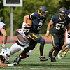 Contributed-University of Rochester Quarterback Daniel Bronson, 2, plays in a football game. Bronson recently tackled a criminal.