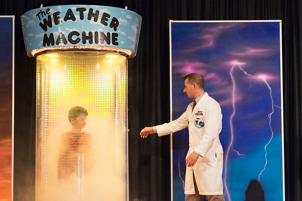 JOED VIERA/STAFF PHOTOGRAPHER- Lockport, NY-Andy Parker goes to open the Weather Machine as the Nikhil Bath, 6, watches fog rise while standing in Parker's machine at Roy-Hart Elementary School.