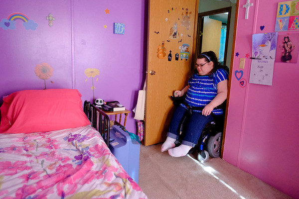 JOED VIERA/STAFF PHOTOGRAPHER- Lockport, NY-Destiny Constantin carefully makes her way through  the narrow doorway to her room.