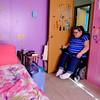 JOED VIERA/STAFF PHOTOGRAPHER- Lockport, NY-Destiny Constantin carefully makes her way through  the narrow doorway to her room.