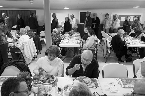 JOED VIERA/STAFF PHOTOGRAPHER-Middleport NY-Carol Mullaney and John Palmer join a crowd of hungry voters gather at Middleport Methodist Church to eat an Election night turkey dinner.