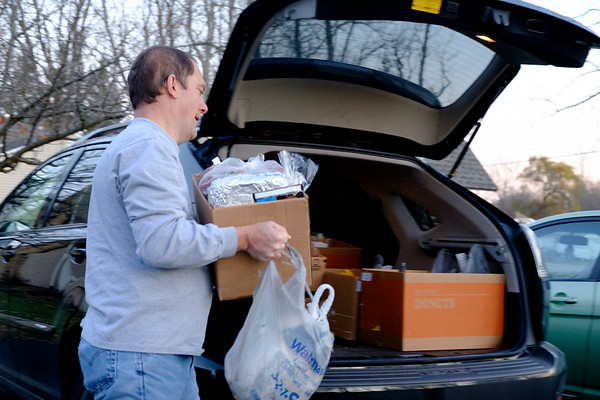 JOED VIERA/STAFF PHOTOGRAPHER- Lockport, NY-SERV volunteer Jeff Glajch fills up his car with thanksgiving dinners being donated to veterans by the organization.
