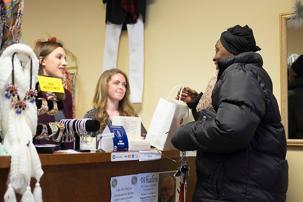JOED VIERA/STAFF PHOTOGRAPHER-Lockport, NY-    Charlene McClain picks up a scarf from Bling on Market Street during Lockport's Shop small event.