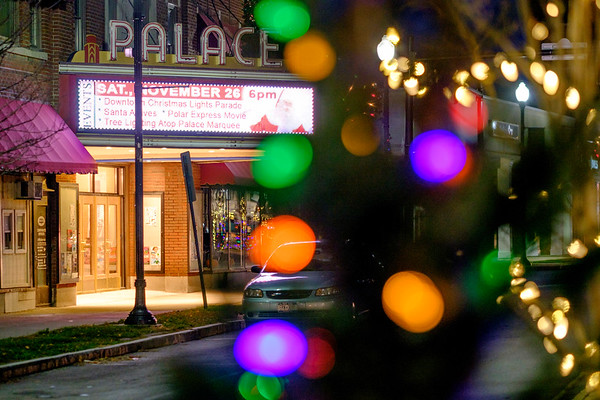 JOED VIERA/STAFF PHOTOGRAPHER-Lockport, NY- Lights cover the trees on a Main Street median as the Palace Marquee advertises Saturday's Christmas Parade.
