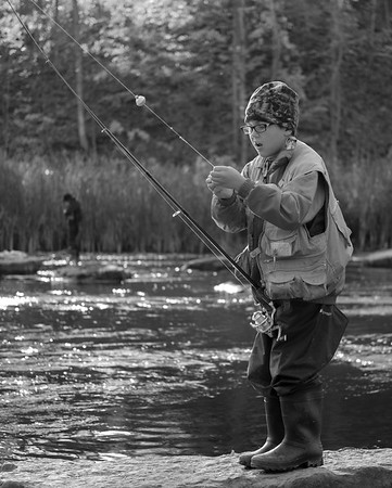 JOED VIERA/STAFF PHOTOGRAPHER-Burt, NY-Owen Arthurs, 9, sets up his rod at Fishermans Park.