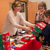 JOED VIERA/STAFF PHOTOGRAPHER-Cambria, NY- Louise Ball watches her grandson Keagan Schaal, 7,deliver two shoeboxes for Operation Christmas Child volunteer Dawn Becker at Community Bible Church.