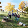 JOED VIERA/STAFF PHOTOGRAPHER-Lockport, NY- Dennis Devine, Frank Rose, Randy Kaiser and Mark Devine stand behind the fallen pieces of the soon to be renovated Whitcher Civil War Monument at Glenwood Cemetary.