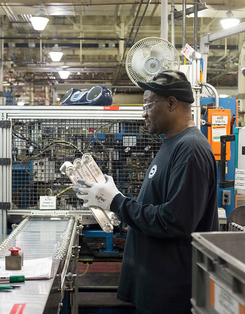 Joed Viera/Staff Photographer Lockport, NY-Cathy Palmer and Floyd Edwards assemble HVAC components at the Lockport General Motors plant after an announcement of the company's plan to invest over $31 million in the holdings plant.