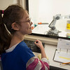 Joed Viera/Staff Photographer Lockport, NY-Cataract Elementary School student Chelsea Faery, 10, handles a robot at the Challenger Center's central command.  Her 5th-grade class won the school's trip to Challenger Center.