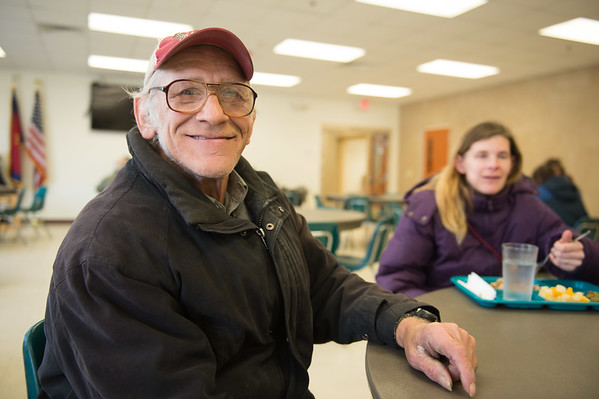 Joed Viera/Staff Photographer Lockport, NY-Wayne Budde and Ashley Falls  enjoy a meal in the Sister Mary Loretto Soup Kitchen at the Salvation Army.