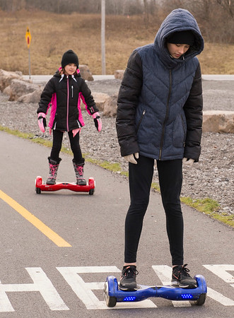 JOED VIERA/STAFF PHOTOGRAPHER-Pendleton, NY-  Mackenzie, 8, and Madison Sommers, 12, ride their hoverboards down the Canal Bike Trail.