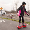 JOED VIERA/STAFF PHOTOGRAPHER-Pendleton, NY-  Mackenzie Sommers, 8, rides her hoverboard down the Canal Bike Trail.