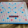 Joed Viera/Staff Photographer Lockport, NY-Donna Sholk and her husband have Scrabble parties to benefit the Buffalo Literacy center using a giant scrabble board. A normal sized board game sits on her dining room table on Friday.