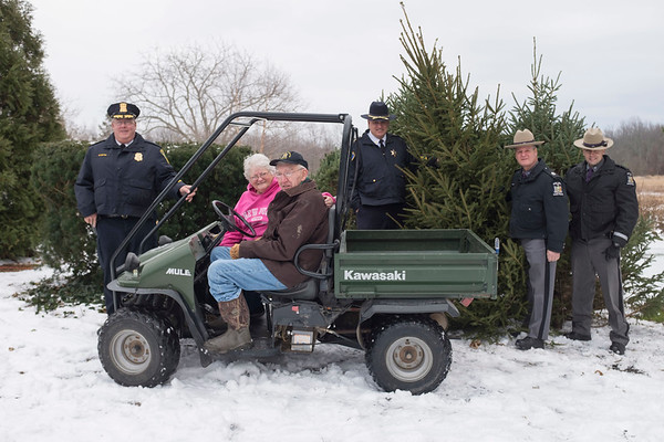 Joed Viera/Staff Photographer Lockport, NY- Lockport Police Chief Mike Niethe, Gretchen Lang, Dick Lang, Niagara County Sheriff James Voutour along with NYS State Troopers Sgt Mike Notto, Trooper Benjamin Litfin stand in front of three trees donated to the police agencys by the Langs in support of Lockport Blue.
