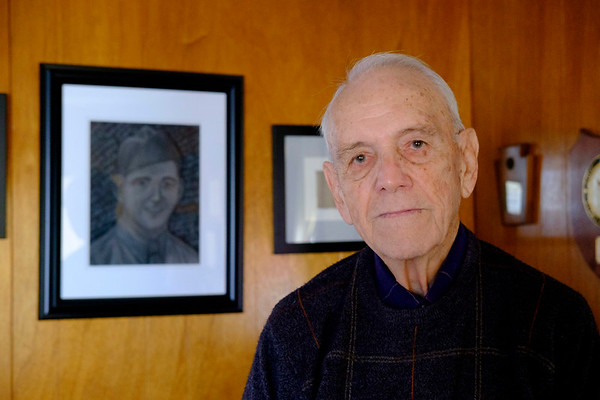 JOED VIERA/STAFF PHOTOGRAPHER-Tonawanda, NY-WW2 Army Veteran Ralph Librock stands in front of a portrait of his younger self made by his grand daughter. Librock served most of the war between Alaska and Canada as a quartermaster for troops building an icy road from British Colombia to Alaska