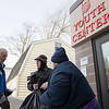 Joed Viera/Staff Photographer Lockport, NY-Larry Eggert and Matt Bowen help Eva Quintern with the Christmas gifts and dinner she picked up at the Salvation Army. 209 additional families showed up to collect gifts and dinners at the Salvation Army as a part of their Christmas Assistance Program on Friday.