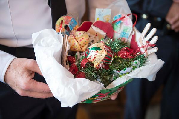 Joed Viera/Staff Photographer Lockport, NY- Niagara County Sheriffs Chief Deputy Steve Preisch holds a basket of ornaments made by students at Desales Catholic School.