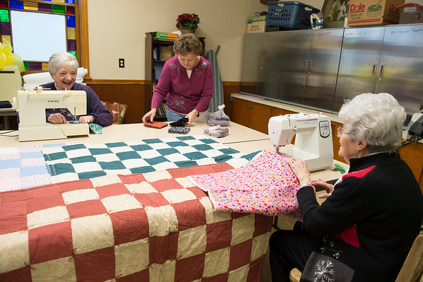 JOED VIERA/STAFF PHOTOGRAPHER-Wilson, NY-  Betty Wiltse, Brenda Myrto and Pauline Alvers work on quilts at Exley United Methodist Church.