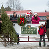 Joed Viera/ Staff Photographer- Pendleton, NY-Todd Ostrowski and AJ mattina along with Tessa, Tricia, Trent and Thomas Ostrowski stand by one of Halmony Farms last Christmas trees.