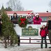 Joed Viera/ Staff Photographer- Pendleton, NY-Todd Ostrowski and AJ mattina along with Tessa, Tricia, Trent and Thomas Ostrowski stand by one of Halmony Farms last Christmas trees.