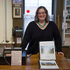 Joed Viera/Staff Photgrapher-Lockport, NY-Jeanette Sheliga stands behind the counter by Shelley Richards' St. Patricks Cemetery book at the Lockport Historical Society.
