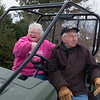 Joed Viera/Staff Photographer Lockport, NY-  Gretchen and Dick Lang sit in their gator parked by front of three trees donated to the police agencies by the Langs in support of Lockport Blue.