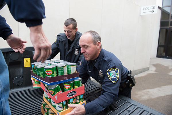 Joed Viera/Staff Photographer- Lockport, NY- Lockport Police officers Steve Tarnowski and Paul Zapp load a truck with boxes packed with canned goods headed to the Salvation Army.
