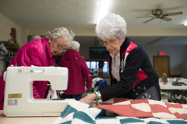 JOED VIERA/STAFF PHOTOGRAPHER-Wilson, NY- Shirley Hunter and Pauline Alvers prepare fabric for a quilt at Exley United Methodist Church.