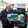 Joed Viera/Staff Photographer- Lockport, NY- Lockport Police Chief Micahel Niethe carries boxes of canned corn and corn bread into the Salvation Army.