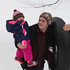 Joed Viera/Staff Photgrapher-Lockport, NY-Lambert Anderson carries a snow tube and his daughter Ema Lear, 1, up a snowy hill after some afternoon sledding at Lockport Town and Country Club.
