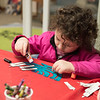 Joed Viera/ Staff Photographer- Lockport, NY-Quinn-Marie Carver, 4 makes a craft menorah during the Lockport Public Library's Hanukkah event.