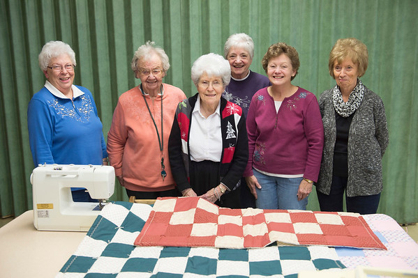 JOED VIERA/STAFF PHOTOGRAPHER-Wilson, NY-Shirley Linnenbank, Shirley Hunter, Pauline Alvers, Betty Wiltse, Brenda Myrto and Lois Barnum stand behind a sewing machine and a few quilts.